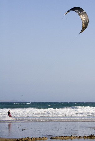 Kite surfing off Great Western Beach at Newquay in Cornwall in the United Kingdom