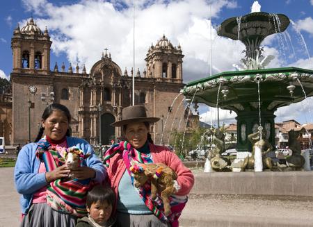 plaza de armas: Local people by the Cathedral in the Plaza de Armas in Cuzco in Peru