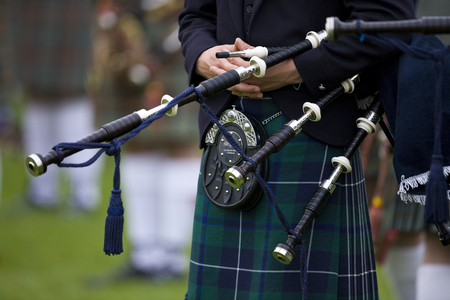Piper at the Cowal Gathering - a traditional Highland Games near Dunoon on the Cowal Peninsula in Scotland