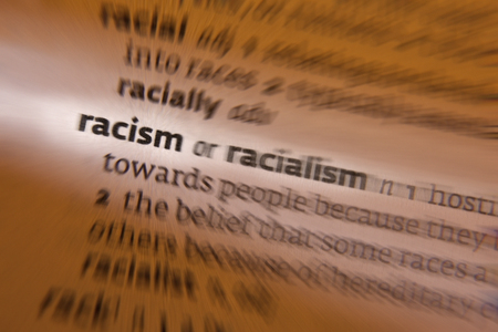 discrimination: Racism -  prejudice, discrimination, or antagonism directed against someone of a different race  Stock Photo