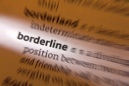 indefinite: Borderline - a division between two distinct  often extreme  conditions