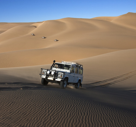 Adventure tourists explore the dunes in the Namib-nuakluft Desert in Namibia