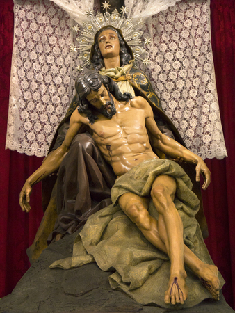 semana santa: Statue of Madonna, the Virgin Mary with her son Jesus Christ in the Semana Santa Museum in the town of Orihuela on the Costa Blanca in Spain