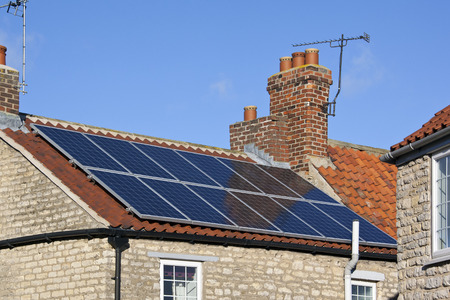 Solar Heating Panels On The Roof Of A House Hot Water Heated.. Stock Photo,  Picture And Royalty Free Image. Image 22450401.