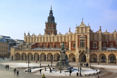 The Cloth Hall and Town Hall Tower in the main market square  Rynek Glowny  in Krakow in Poland  The statue is of Adam Mickiewicz   The Cloth Hall dates from 1895