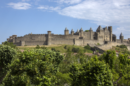 walled: The medieval fortress and walled city of Carcassonne in south west France  Founded by the Visigoths in the fith century, it was restored in 1853 and is now a UNESCO World Heritage Site