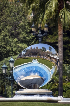 Reflection of the famous Monte Carlo Casino in Mirror Fountain, Monaco  Stock Photo - 22450537