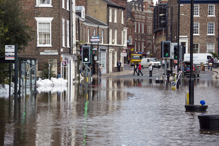 ouse: The River Ouse floods the streets of central York in the United Kingdom  - September 2012  Editorial