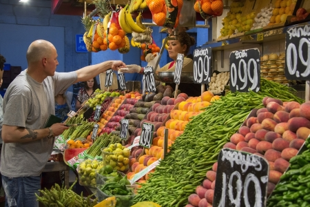 storekeeper: The famous St Joseph Food Market in the Eixample district of Barcelona in the Catalonia region of Spain