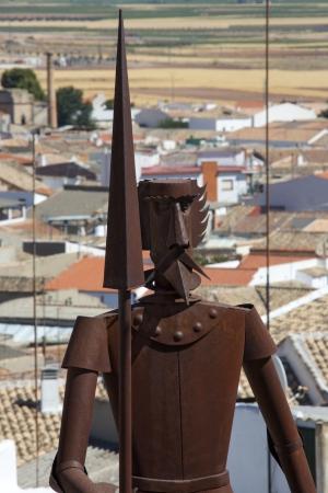 don quixote: Metal sculpture of Don Quixote in the village of Campo de Criptana, famous for its windmills Editorial