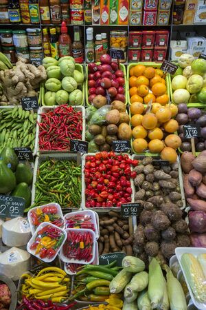 Display of food and fresh vegetables on a market stall in the famous St Josephs Market in Bacelona in Spain