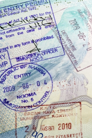 certifying: Visa Stamps in a European Passport - This is an official document issued by a government, certifying the holder