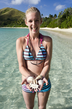 Beachcombing on a tropical island in Fiji in the South Pacific  photo