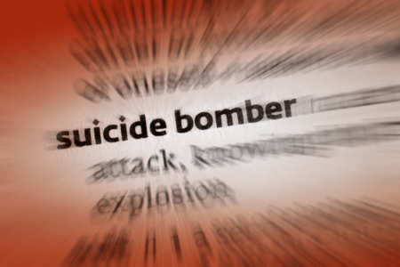 attacker: Suicide Bomber - A suicide attack is an attack upon a target, in which an attacker intends to kill others and or cause great damage, knowing that he or she will either certainly or most likely die in the process  Stock Photo