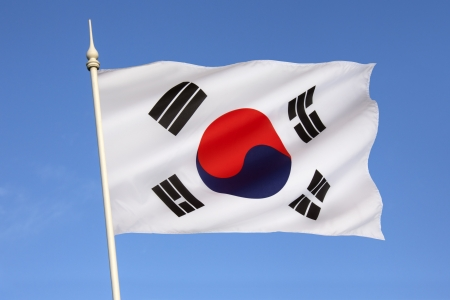 The flag of South Korea, or Taegeukgi has three parts - a white background, a red and blue taegeuk  also known as Taiji and Yinyang  in the center, and four black trigrams, one in each corner of the flag   Stock Photo