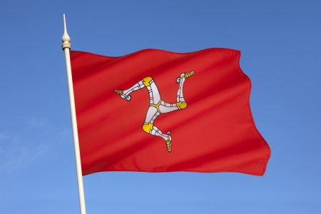 mann: The flag of the Isle of Man is a triskelion, composed of three armoured legs with golden spurs  It has been the official flag of Mann since 1931 and is based on the Manx coat of arms, which dates to the 13th century  Stock Photo