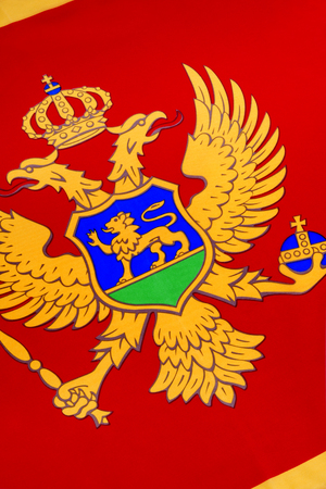 constitutionally: The national flag of Montenegro was officially adopted on the statehood day of Montenegro on 13 July 2004 at the proposal of the government of Montenegro  It was constitutionally sanctioned with the proclamation of the Constitution on 22 October 2007