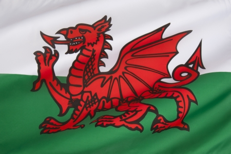 The flag of Wales in the United Kingdom  The flag incorporates the Red Dragon of Cadwaladr, King of Gwynedd, along with the Tudor colours of green and white   photo