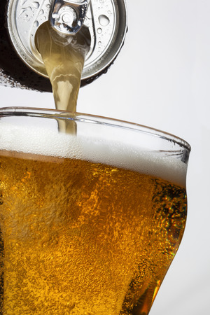 Pouring ice cool beer from a ring pull can