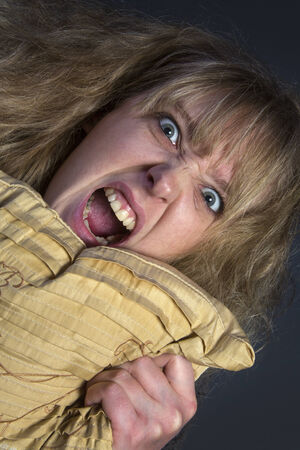 An hysterical young woman photo