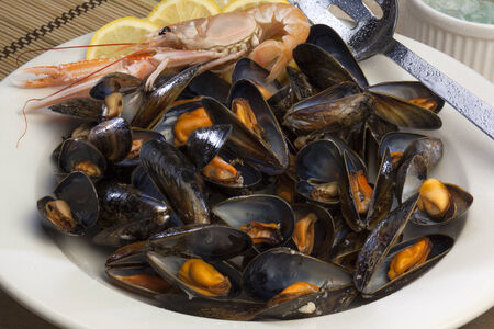 internationally: Moules Marinieres  Probably the most common and internationally recognisable recipe, Moules marinieres includes white wine, shallots, parsley and butter to cook the mussels  Stock Photo