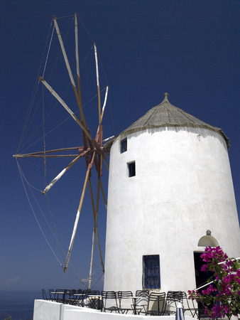the mainland: Windmill on the Greek island of Santorini in the Cyclades in the Aegean Sea off the coast of mainland Greece  Stock Photo