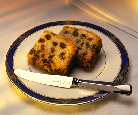 fruitcake: Fruit cake  or fruitcake  is a cake made with chopped candied fruit, dried fruit, nuts, and spices, and  optionally  soaked in spirits