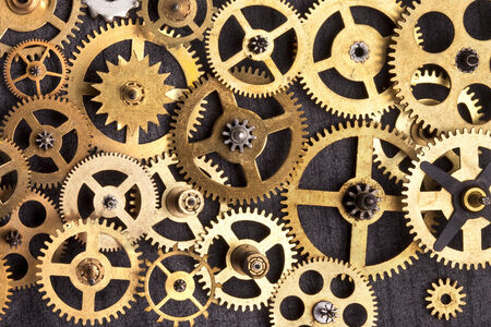 Selection of old brass clockwork cogs  photo