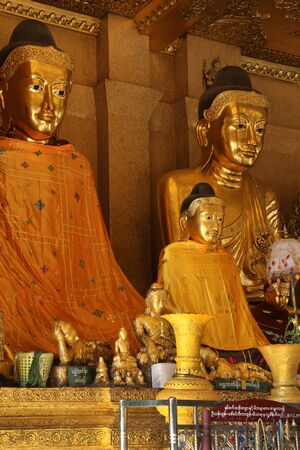 daw: Buddha images in the Shwedagon Pagoda, officially titled Shwedagon Zedi Daw, in the city of Yangon in Myanmar