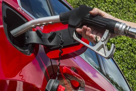fueled: Pumping Gas - Filling a car fuel tank with diesel