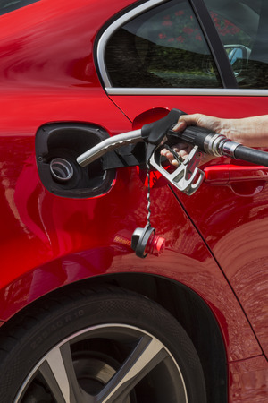 Pumping Gas - Filling a car fuel tank with diesel or petroleum