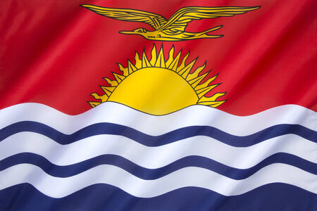 upper half: The flag of Kiribati is red in the upper half with a gold frigatebird, and the lower half is blue with three horizontal wavy white stripes to represent the ocean and the three groups (Gilbert, Phoenix and Line Islands). The 17 rays of the sun represent th