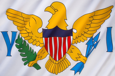 us territory: The flag of the United States Virgin Islands was adopted in 1921. It consists of a simplified version of the coat of arms of the United States between the letters V and I (for Virgin Islands). Stock Photo