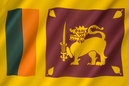 sri lankan flag: The flag of Sri Lanka, also called the Lion Flag, features a gold lion, holding a kastane sword in its right fore paw, with four golden bo leaves, one in each corner. It was adopted in 1950.