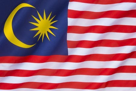 The national flag of Malaysia, also known as the Jalur Gemilang (Malay for Stripes of Glory). The flag was first raised on 16th September 1963, and originated from the flag of the Federation of Malaya.