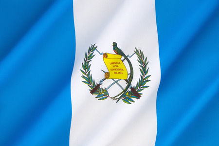 signifies: Flag of Guatemala - The two sky blue stripes represent the fact that Guatemala is a land located between two oceans, the Pacific Ocean and the Atlantic Ocean. The white color signifies peace and purity. Adopted in 1871. Stock Photo