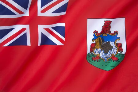 genera: The Flag of Bermuda was adopted on 4th October 1910. It is a British Red Ensign and is unusual for a British overseas territory in that it is used on land in a red ensign form. Other British overseas territories use a version of the blue ensign for genera