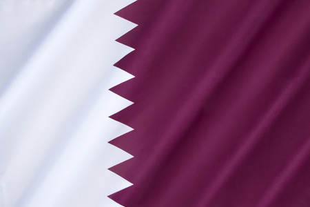 ensign: National flag and ensign of Qatar - The flag was officially adopted on July 9, 1971, although a nearly identical flag (only differing in proportion) had been used since 1949.