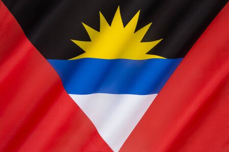 samuel: The national flag of Antigua and Barbuda was adopted on February 27th 1967. It was designed by a nationally acclaimed artist and sculptor, Sir Reginald Samuel. Stock Photo