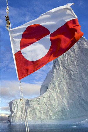 nordic country: Flag of Greenland - Adopted 21st June 1985. The flag of Greenland is the only national flag of a Nordic country or territory without a Nordic Cross. Photographed in Scoresbysund, eastern Greenland. Stock Photo