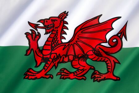 incorporates: Flag of Wales - United Kingdom. The flag incorporates the Red Dragon of Cadwaladr, King of Gwynedd, along with the Tudor colors of green and white. Stock Photo