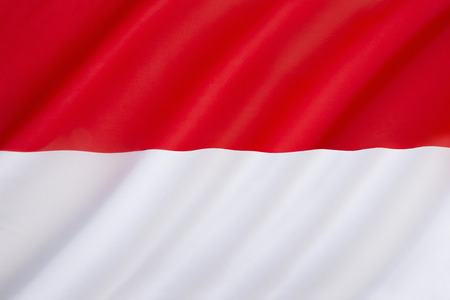 The national flag of Indonesia, which is known as Sang Saka Merah-Putih. Based on the banner of the 13th century Majapahit Empire in East Java. The flag was introduced on Independence Day on 17th August 1945.