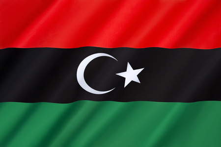 constitutional: Flag of Libya - originally introduced in 1951. It fell out of use in 1969, but was subsequently adopted by the National Transitional Council and anti-Gaddafi forces and formally reclaimed as the Libyan national flag in the interim Constitutional Declarati