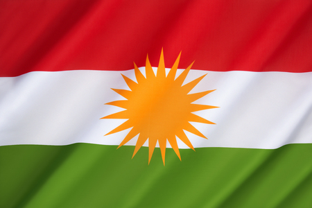 under control: Flag of Kurdistan - currently used as the official flag of the autonomous Kurdistan Region in Iraq which is under control of the Kurdistan Regional Government. The flag is banned in Turkey, Iran and Syria. Stock Photo