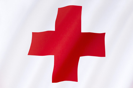 natural disaster: Flag of the Red Cross - the International Movement of the Red Cross and the Red Crescent, are international humanitarian organizations bringing relief to victims of war or natural disaster. The Red Cross was set up in 1864. Stock Photo