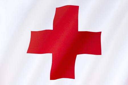 rood kruis: Vlag van het Rode Kruis - de Internationale Beweging van het Rode Kruis en de Rode Halve Maan, zijn internationale humanitaire organisaties brengen noodhulp aan de slachtoffers van oorlog of natuurramp. Het Rode Kruis werd opgericht in 1864. Stockfoto