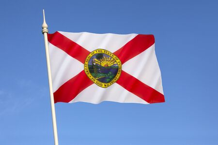 Flag of Florida - United States of America. The flag has a red saltire (St. Andrews Cross) on a white background, with the state seal in the center. The current design has been in use since 21st May 1985. Reklamní fotografie