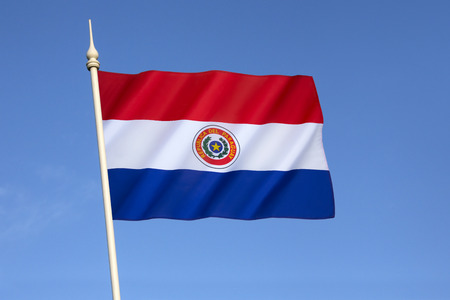 obverse: National flag of Paraguay - adopted in 1842. It is unusual because the insignia differs on obverse and reverse sides of the flag (this the obverse side).