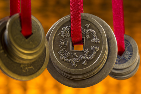Antique Chinese coins in a hotel in Beijing in China. Stock Photo