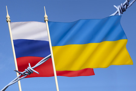 disputed: Flags of Russia and Ukraine - The ongoing crisis in Ukraine began on 21st November 2013 Stock Photo